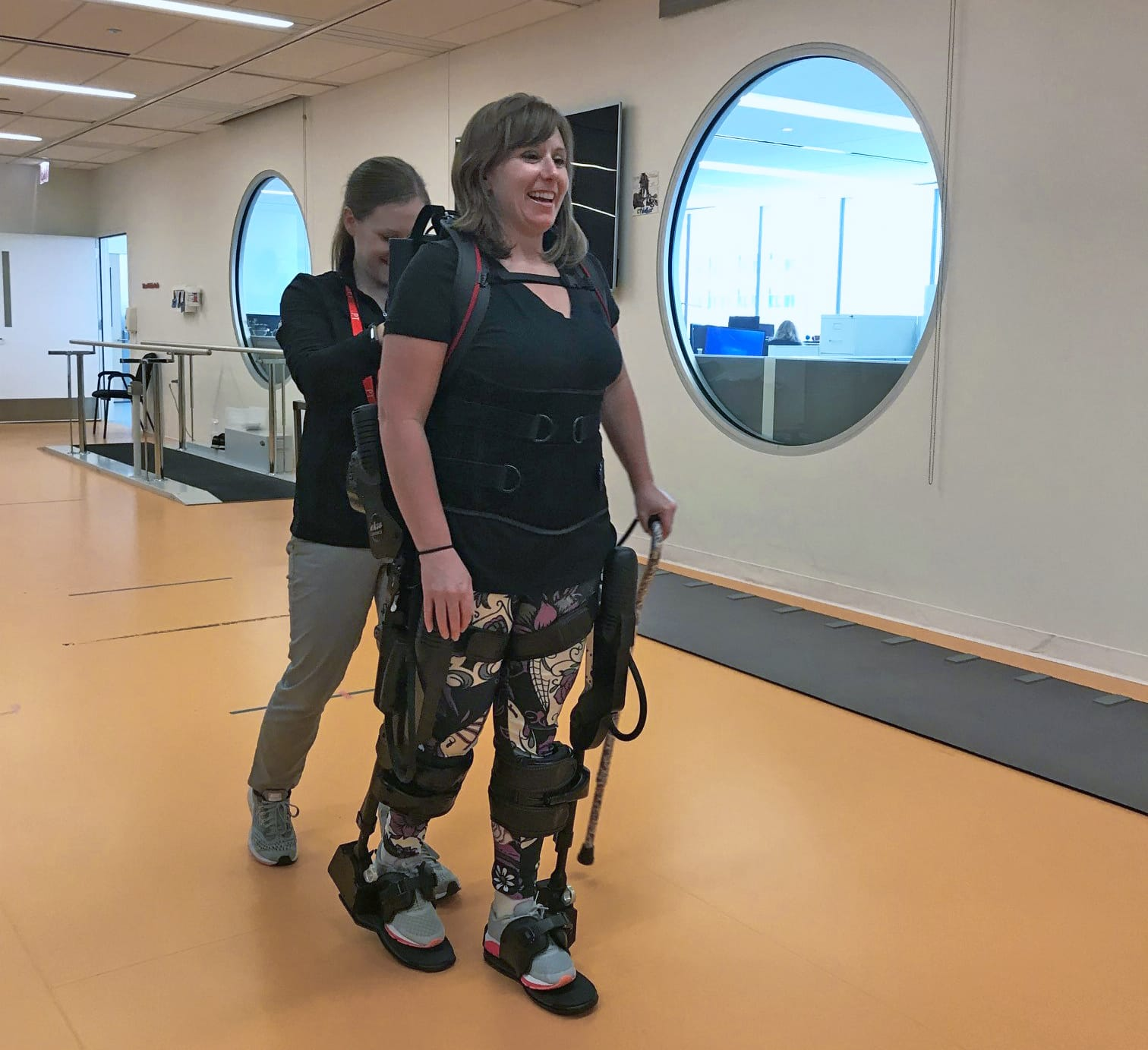 Image of Megan Burns taking assisted steps with Ekso Bionics' exoskeleton suit.